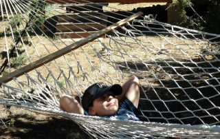 boy relaxing in hammock